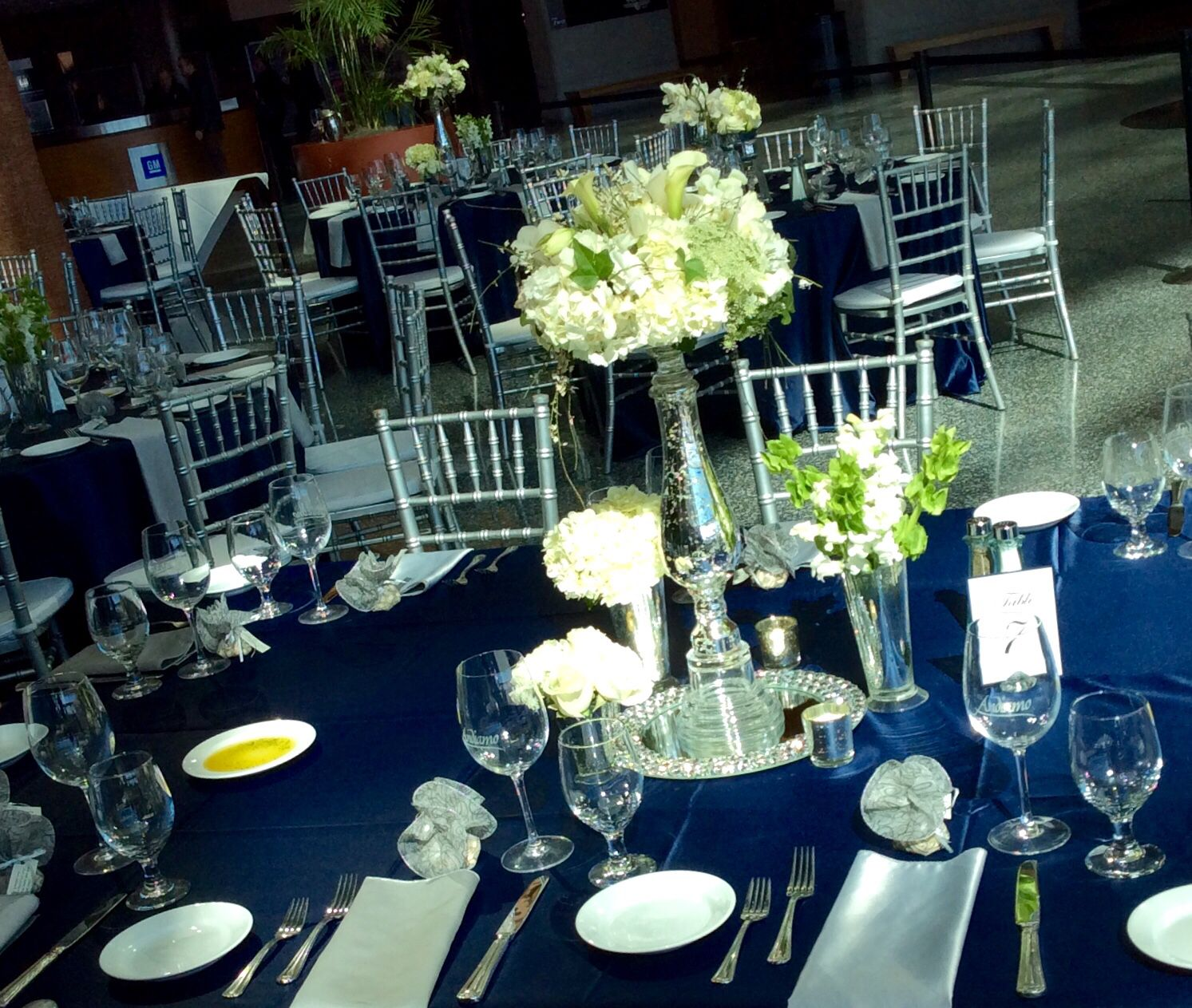Wedding reception guest table flowers centerpieces navy