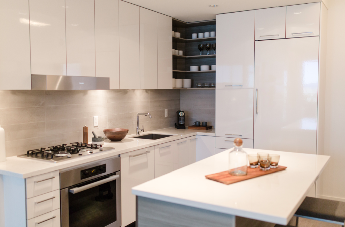 white kitchen cabinets, faux marble quartz counters, corner cabinet ...