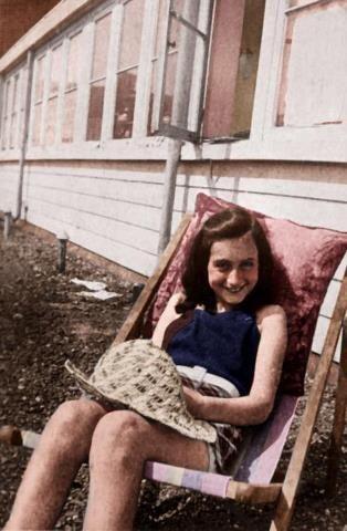 Jewish diarist Anne Frank sunbathes on her roof, 1939.