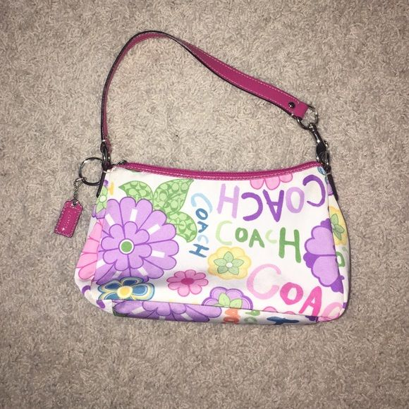 Floral pattern coach mini hand bag Floral pattern canvas material coach hand bag colors are white pink purple blue green orange and yellow barely used Bags Mini Bags