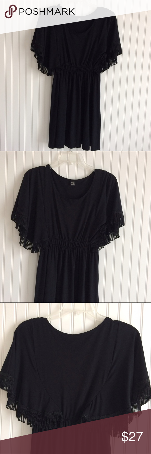 Only hearts fringed sleeve black dress size L Very versatile black dress. Can be worn alone or with a great belt. It can also be used as a swimsuit coverup. It has an elastic waistband. It is in very good condition. No rips or stains onlyhearts Dresses Mini