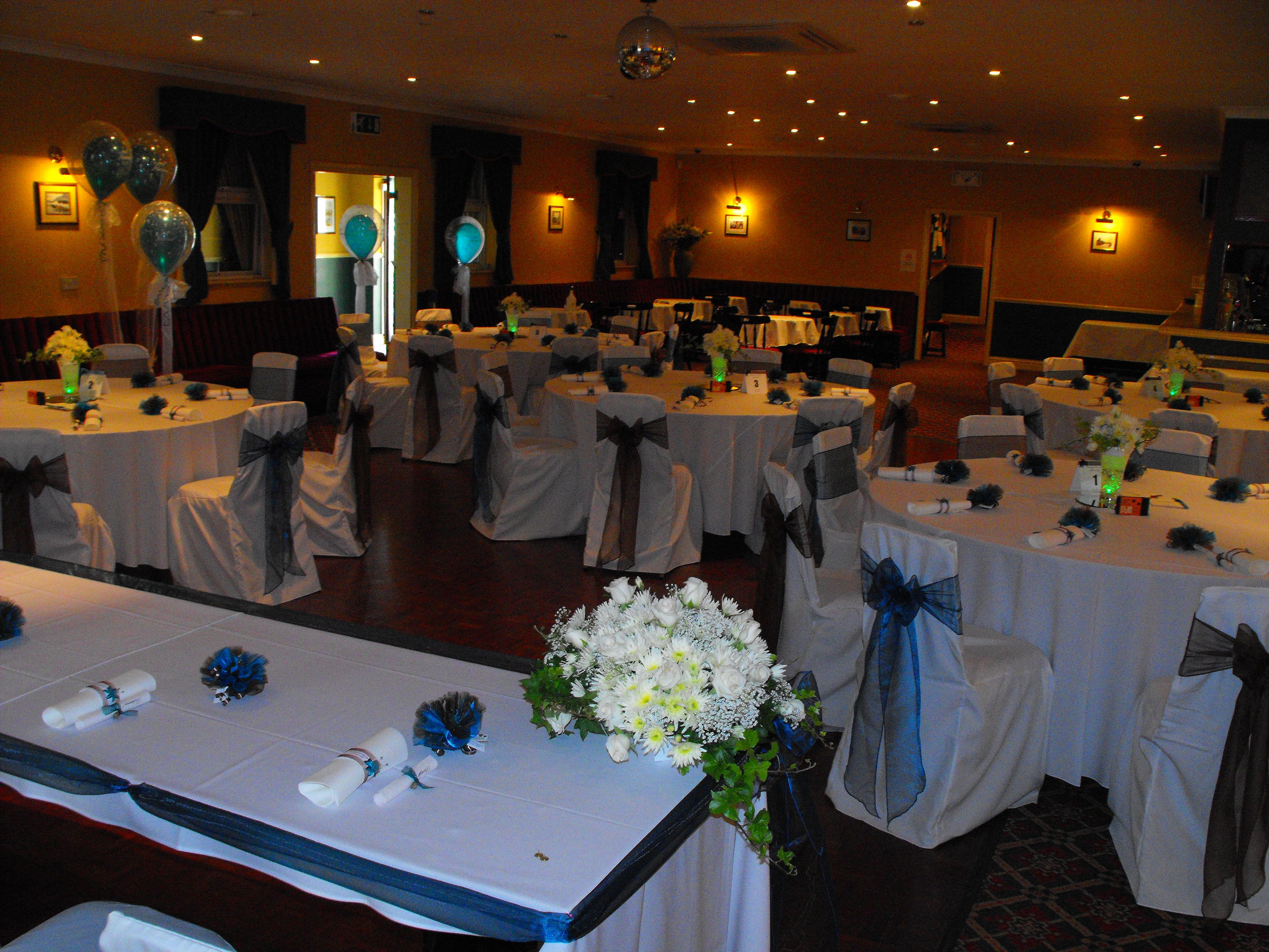 7397e6e67bd70f Alternating Teal and Chocolate Organza Bows on White Chair Covers ...