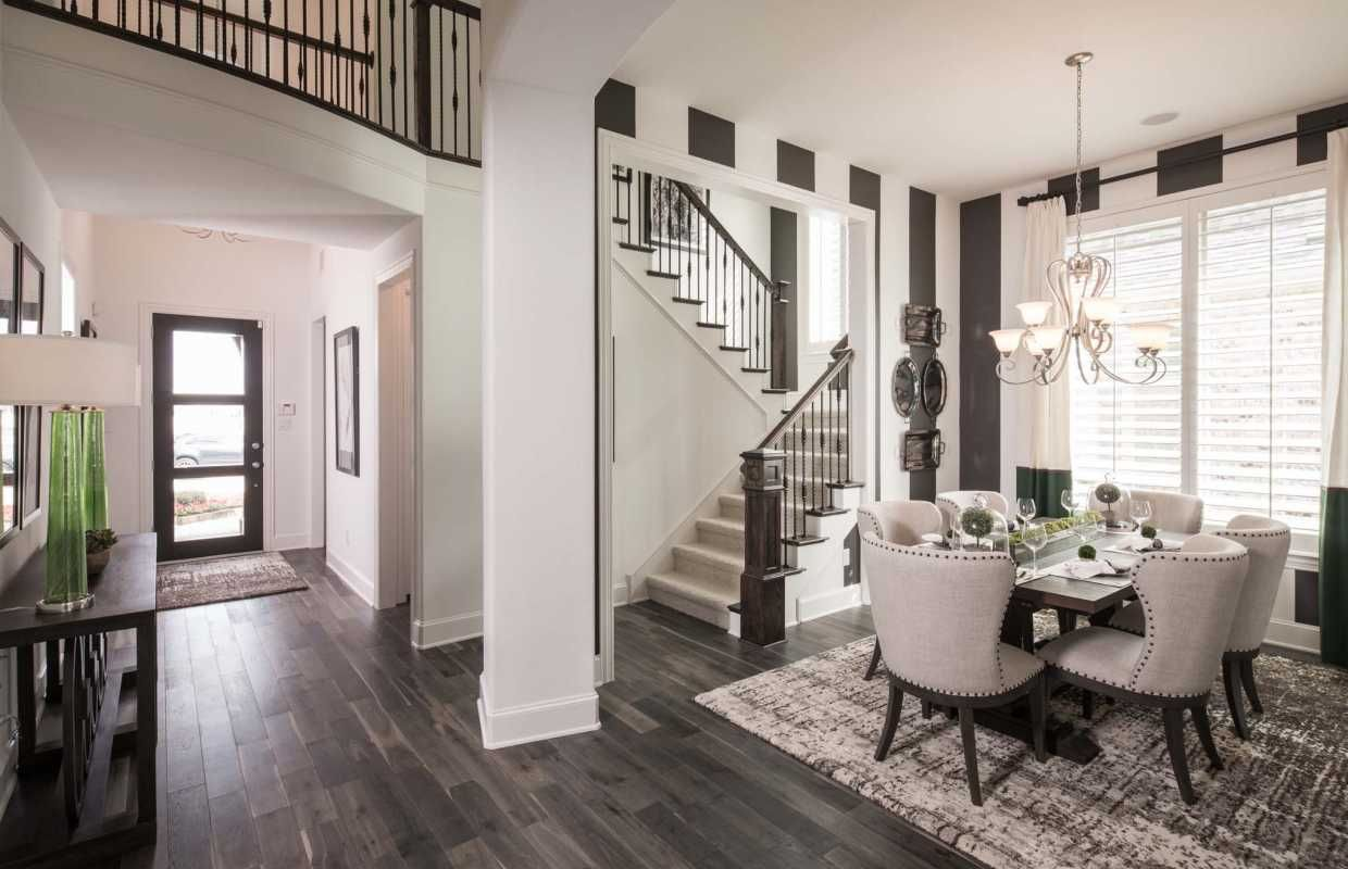 This Entryway Opens Up Right Into A Two Story Hallway And Chic Dining Room
