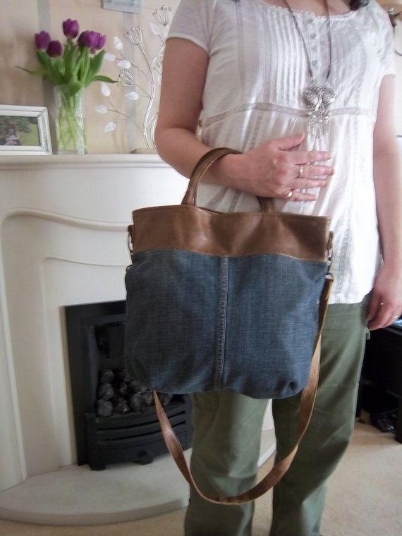 Tan Lederjacke und ein paar Stein waschen Jeans neu in dieser ...