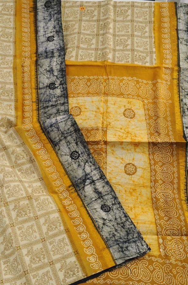 Sungudi cotton sari cream yellow figures $58 http://sarishop.com/zencart/index.php?main_page=product_info&cPath=38_41&products_id=1286
