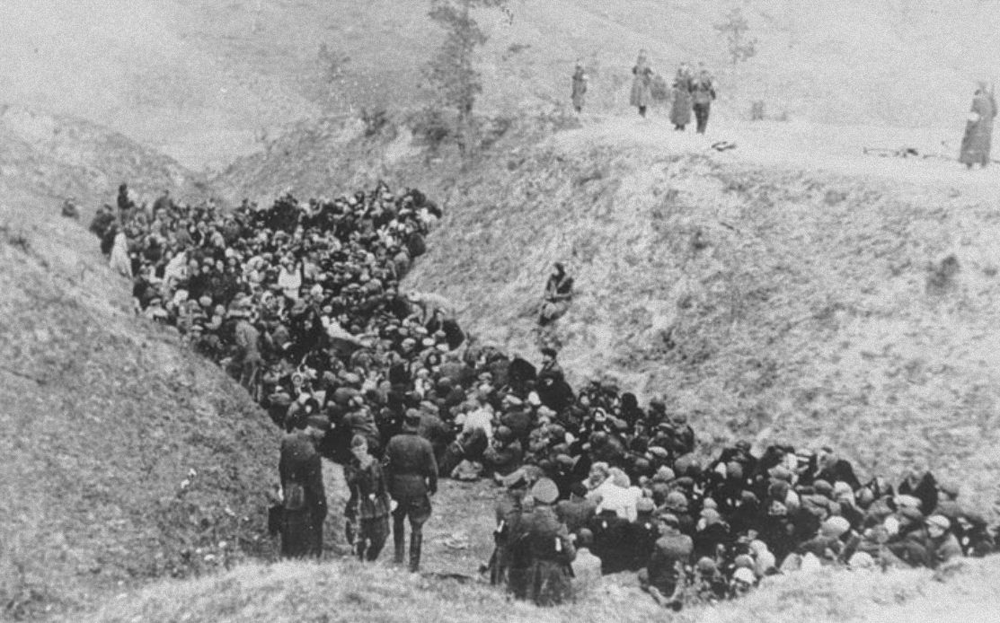 Ww2 • A large group of Jews awaits execution in a ravine either at Belzec or Sobibor Death Camps ...
