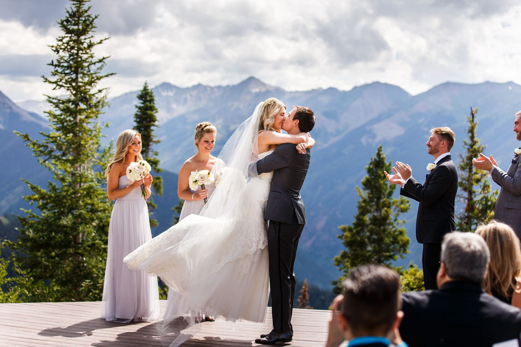 First kiss on Aspen Wedding Deck at The Little Nell