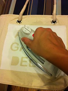 Freezer paper as a stencil- you iron on to seal it to the fabric before painting- I can't wait to try!