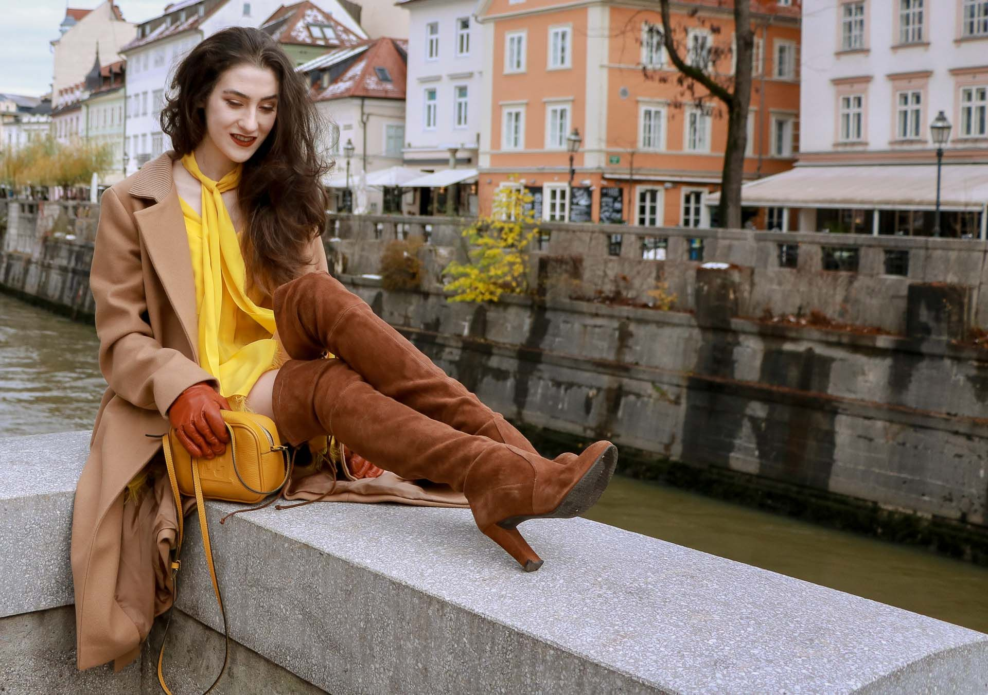 a011220d621 Beautiful Slovenian Fashion Blogger Veronika Lipar of Brunette from Wall  wearing Escada camel wrap coat