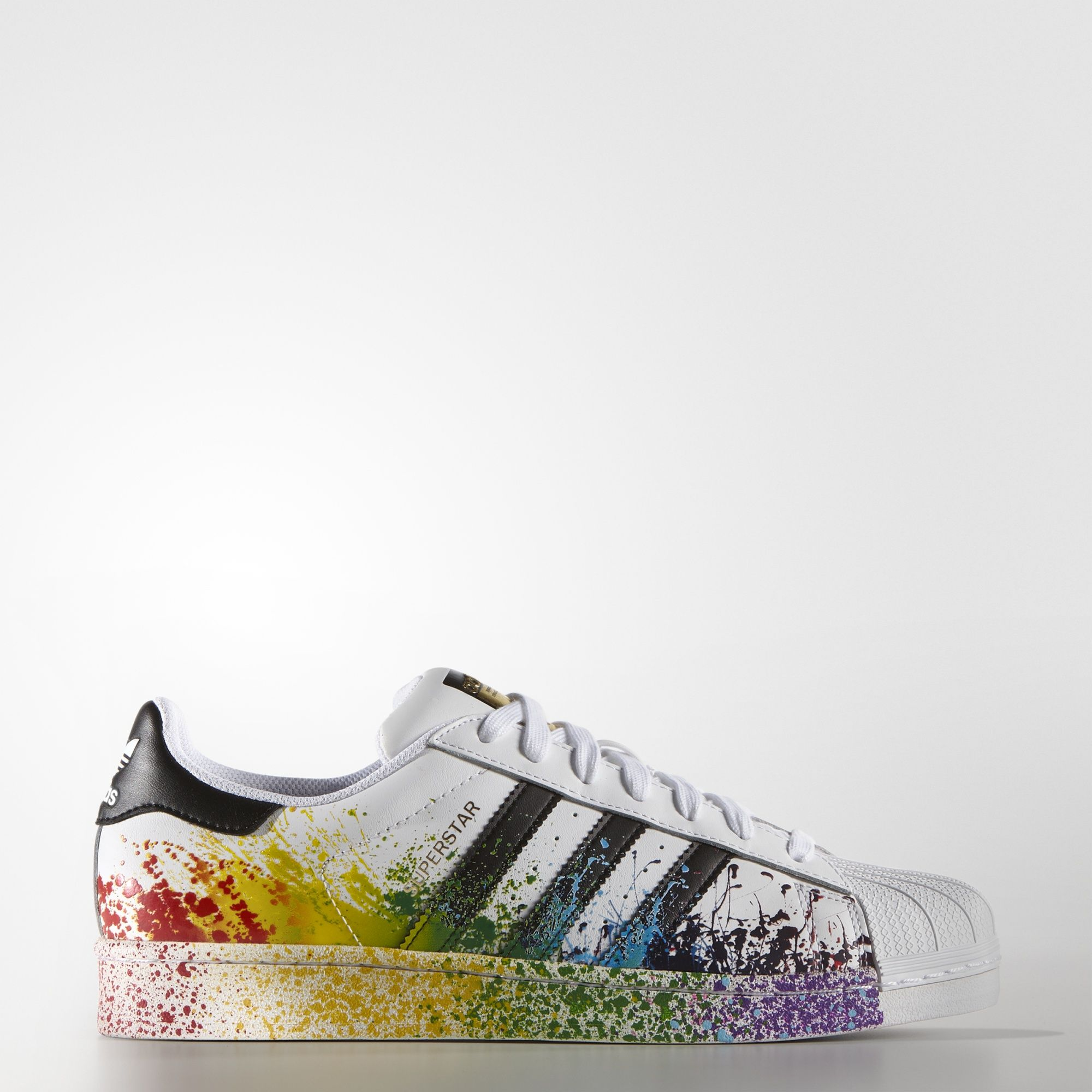 reputable site 759b0 b3d48 adidas Originals celebrates Pride 2016 with a vibrant LGBT Pride  collection. These men s Superstar shoes rock the rainbow with an  eye-catching splatter ...