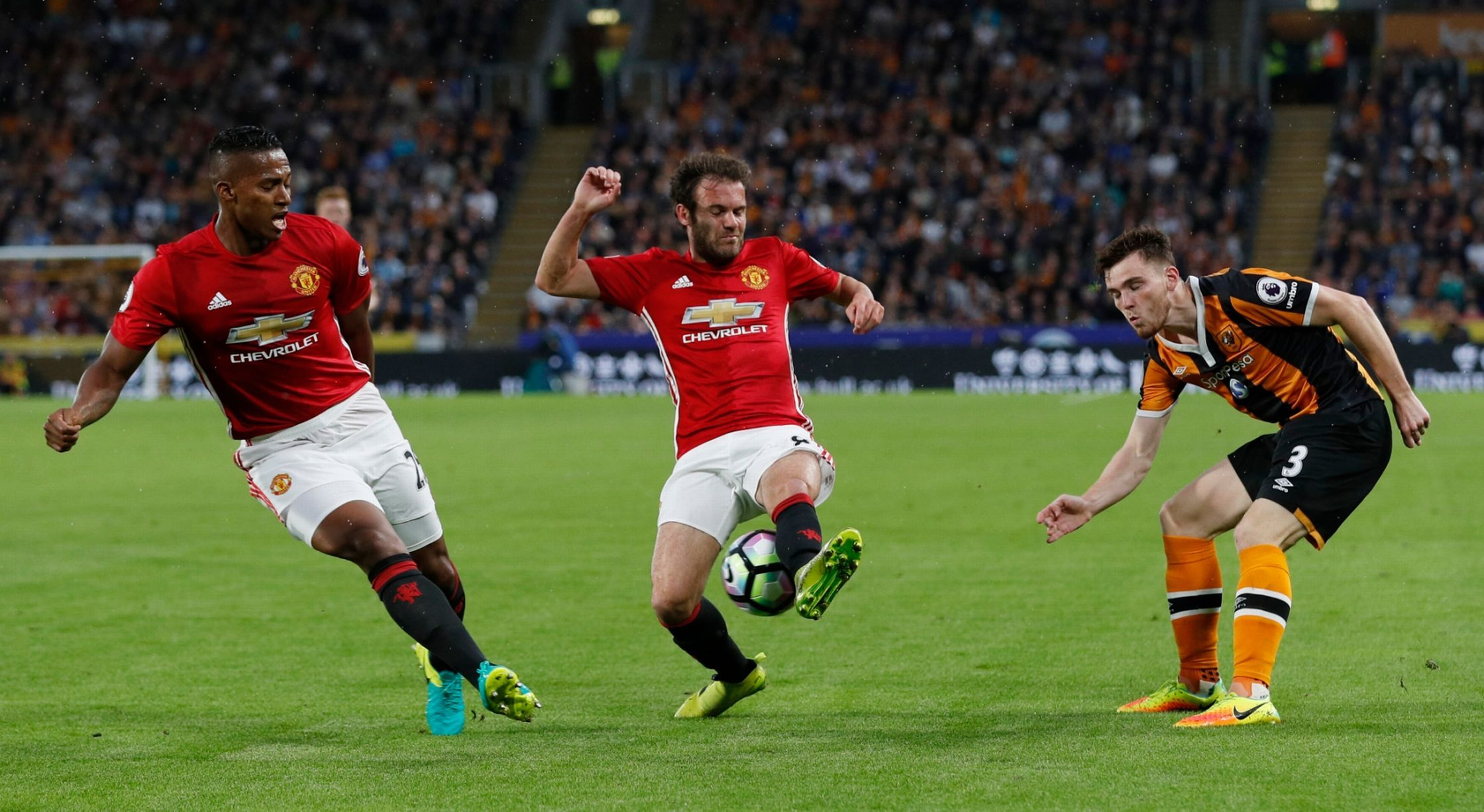 Antonio Valencia And Juan Mata In Action With Andrew