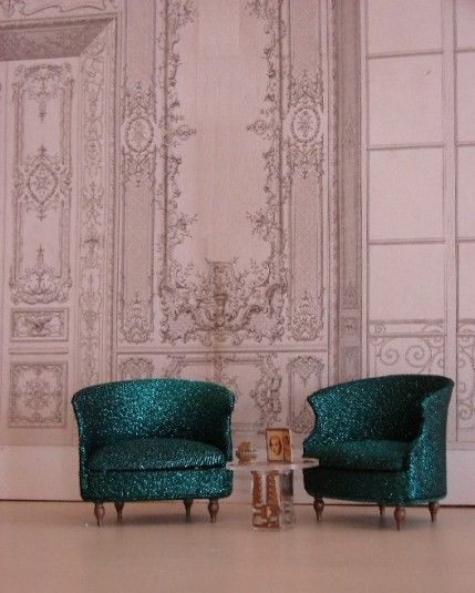 Teal Glitter Chairs, Lucite Side Table and Cool French Walls.