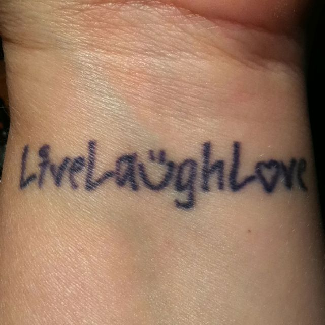 wrist tattoo ... Live Laugh Love but would have the lettering done differently and no smiley face
