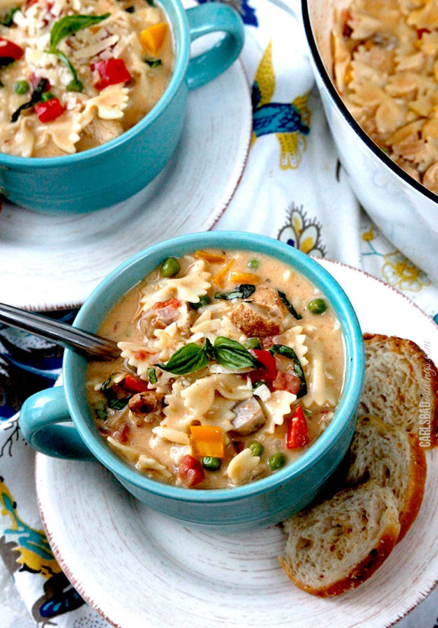 Creamy Cajun Chicken Pasta Soup – This cozy, palate-pleasing dish is bursting with flavor—filled with Cajun spices, bell peppers, tomatoes, mushrooms and peas!