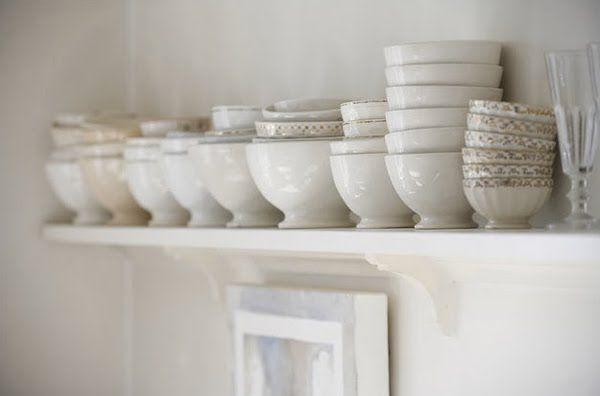 Pretty White Bowls On A Shelf Wall