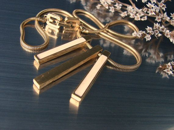 #Givenchy 1977 gold bar necklace. Snake choker by OnceLostBoutique