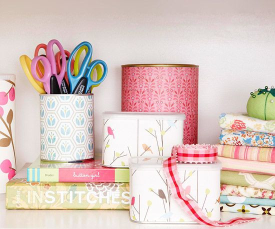 Turn coffee tins and powdered drink tubs into storage containers by covering them with decorative paper. More inexpensive storage ideas: http://www.bhg.com/decorating/storage/organization-basics/simple-storage-for-less/?socsrc=bhgpin060512