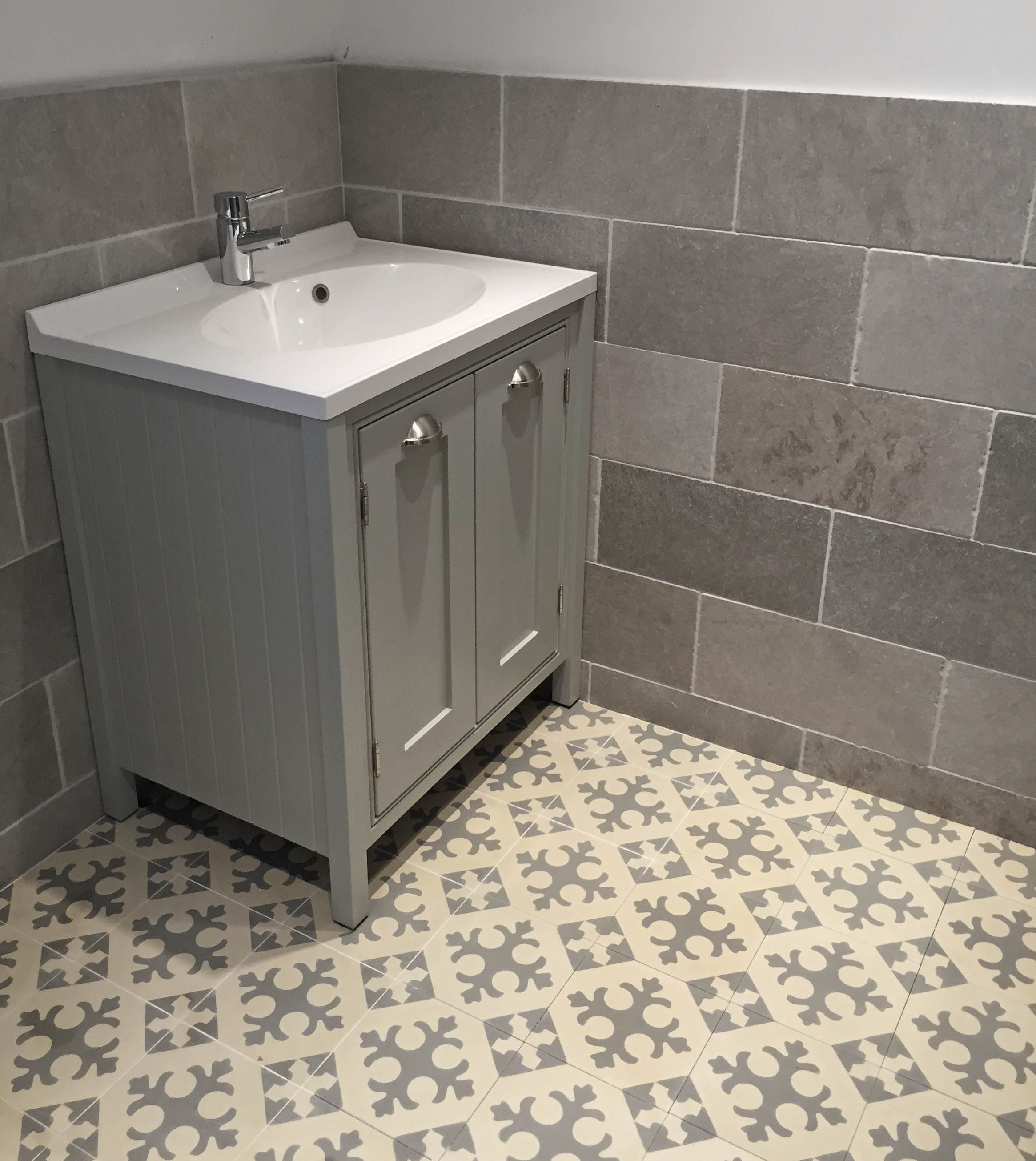 Grey limestone wall tiles and Moroccan encaustic cement ...
