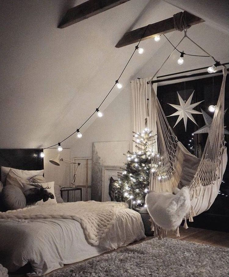 The hammock chair looks fun and i love the lights for Hanging bedroom