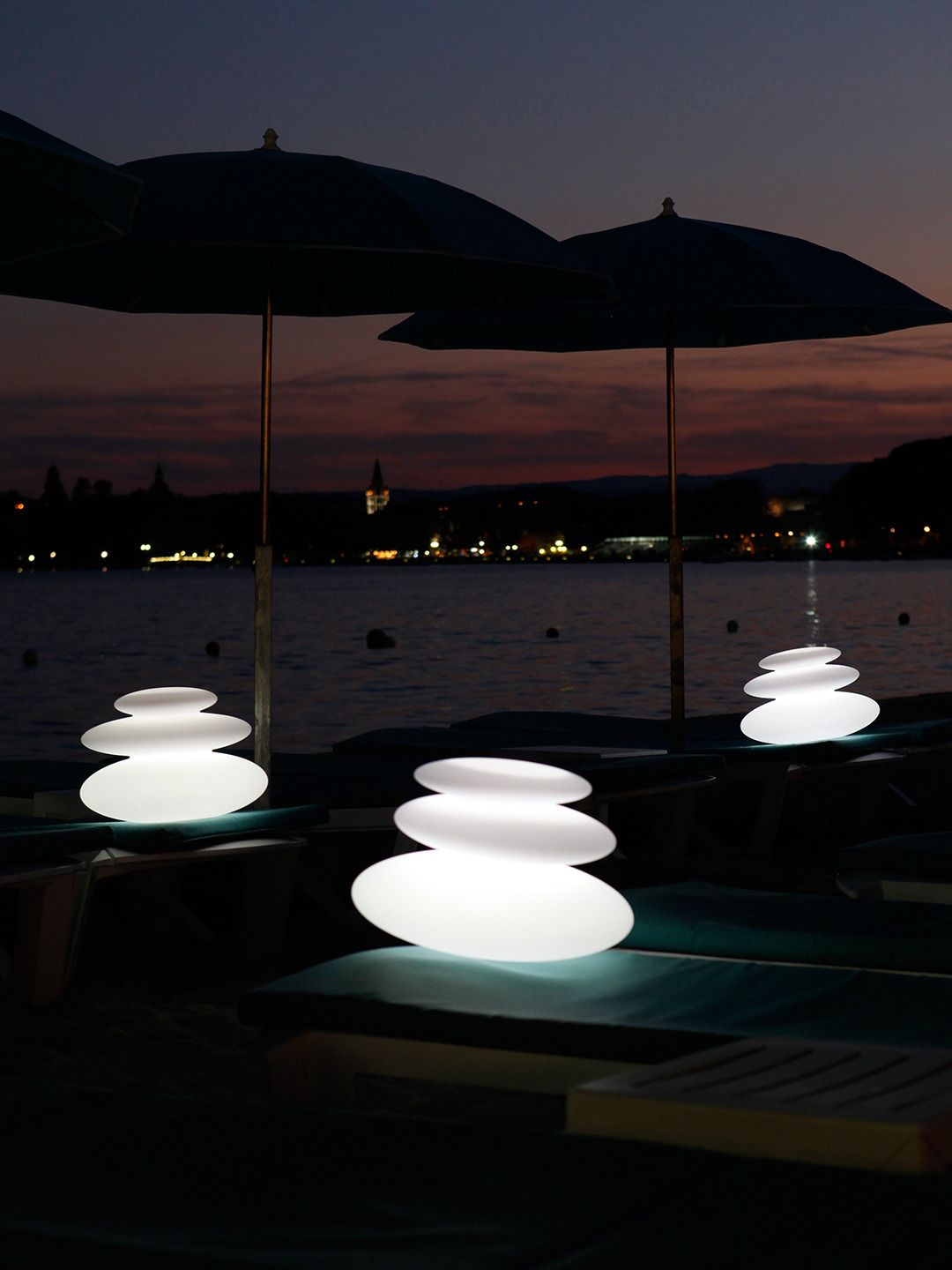 Zen:    Rechargeable LED indoor/outdoor lamp  Made from injection-molded high density polyethylene  Evoking three smooth pebbles laid on top of each other for a serene and calming display  Eco-friendly, waterproof, shockproof and cordless  Lights up with 160,000 colors variations