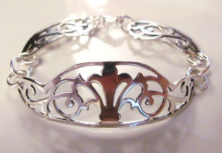Upcycled silver-plate and sterling silver bracelet. Formerly an antique serving platter.