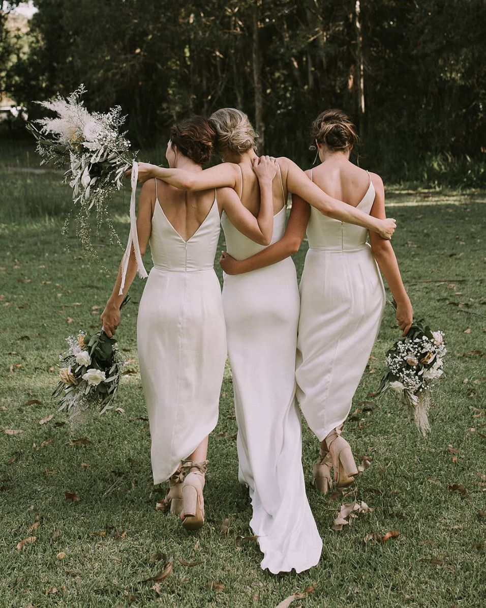 32 All White Bridesmaid Dresses That Are Totally Slaying The Game Ruffled White Bridesmaid White Bridesmaid Dresses Bridesmaid [ 1195 x 956 Pixel ]