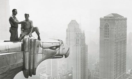 A Construction Worker Lights Fellow Workers Cigarette As They Take Break On Chrysler Building Gargoyle