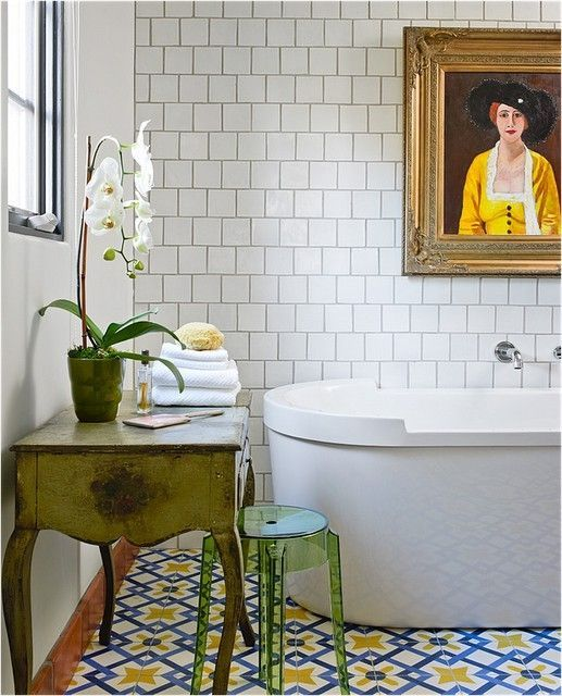 traditional + contemporary bathroom mix, white modern tub, vintage portrait, Lucite stool, French console, white tile