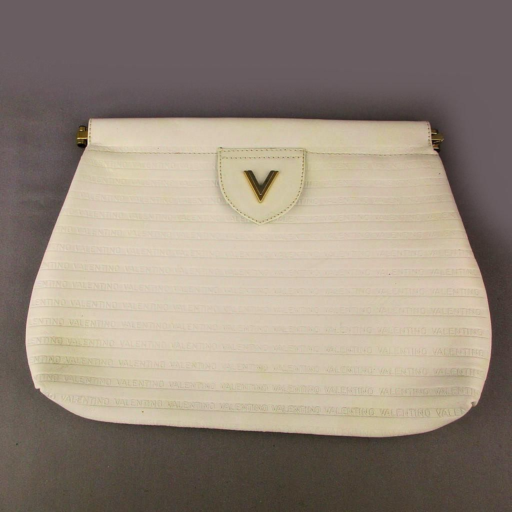 A Great Classic For All Seasons This Genuine Mario Valentino Clutch Handbag Is Made Of White Leather Impress Clutch Handbag Mario Valentino Vintage Valentino