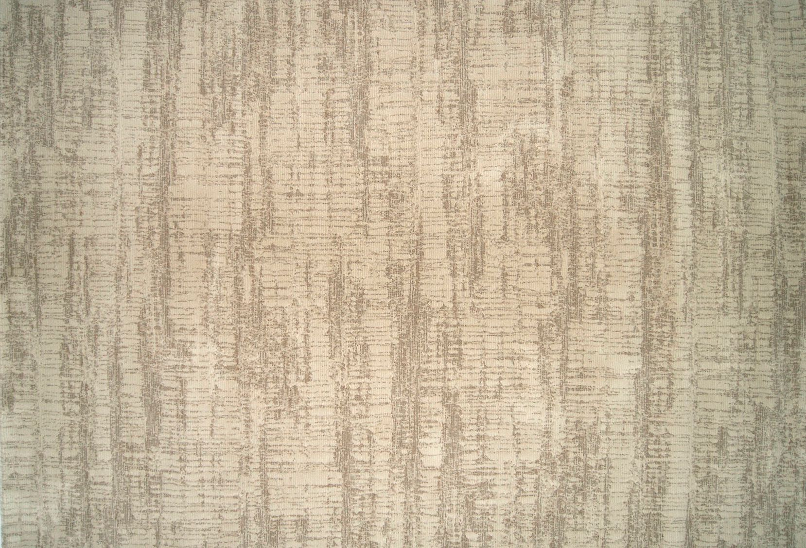 This tan area rug features a criss crossed bark like texture , great for spaces where you want ...