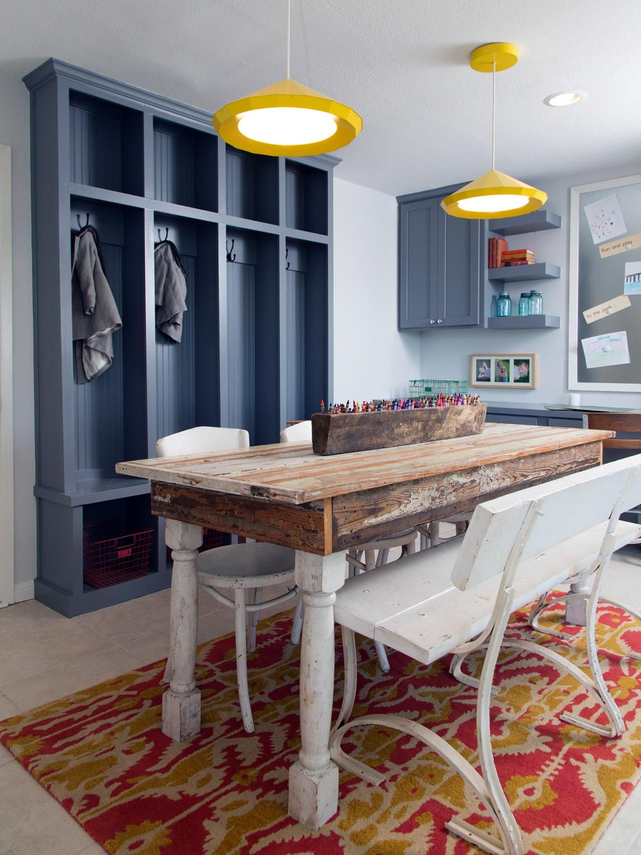A Trio Of Vintage Chairs And A Wood Bench In Distressed White Finish  Provide Seating At The Craft Table While A Boldly Patterned Area Rug Adds A  Vibrant ...