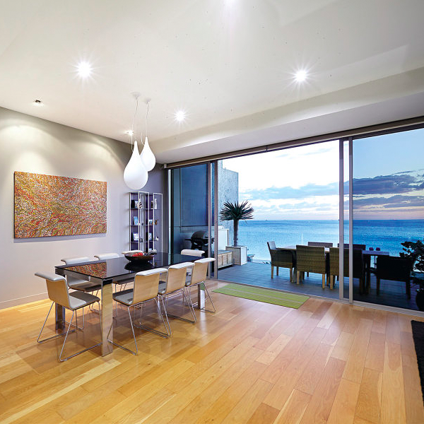 Dining area in this Melbourne, Australia penthouse with a view of Hobson's Bay in the background. Credit to agents: Kayne Lanyon and Sarah Wood of Marshall White.