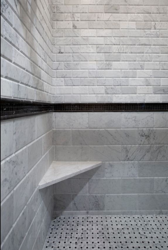 Beveled Bianco Carrara with Basketweave tile floor. Shower tile design.