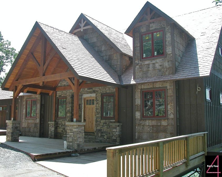 Heavy Timber Entry Way With Cultured Stone Poplar Bark And Board And Batten On Exterior Walls