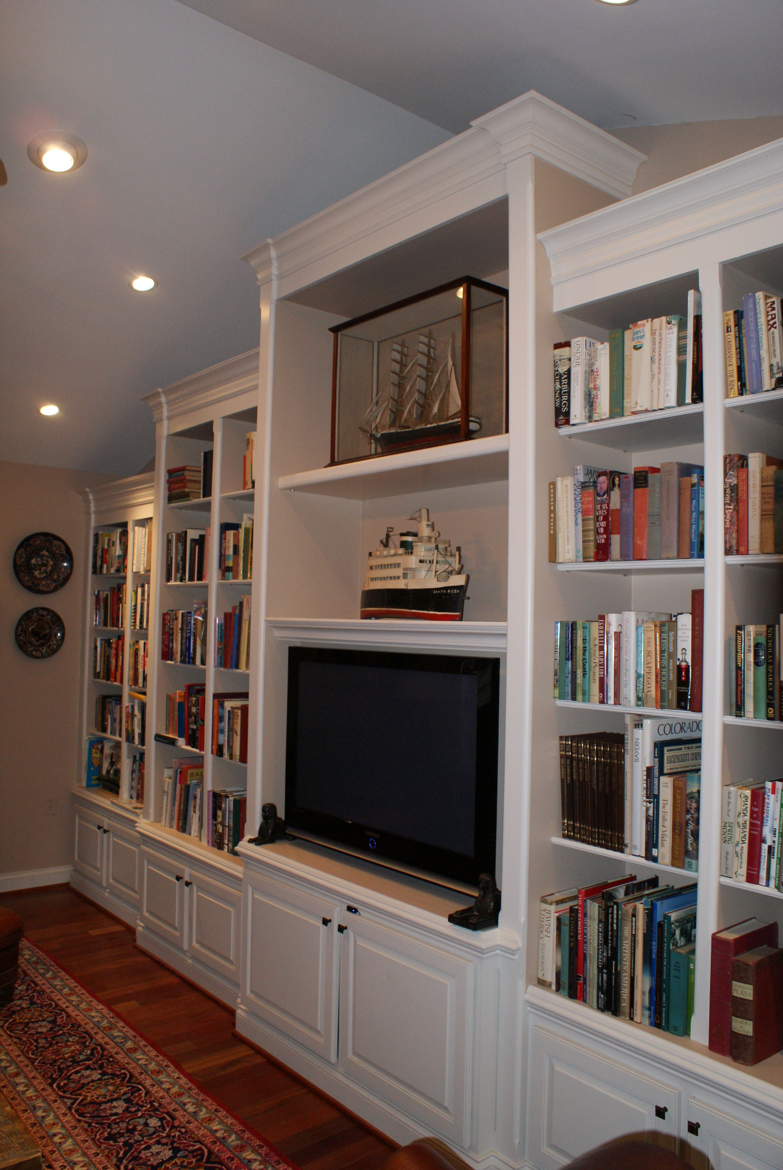 Custom Built In Shelving With Cathedral Ceiling