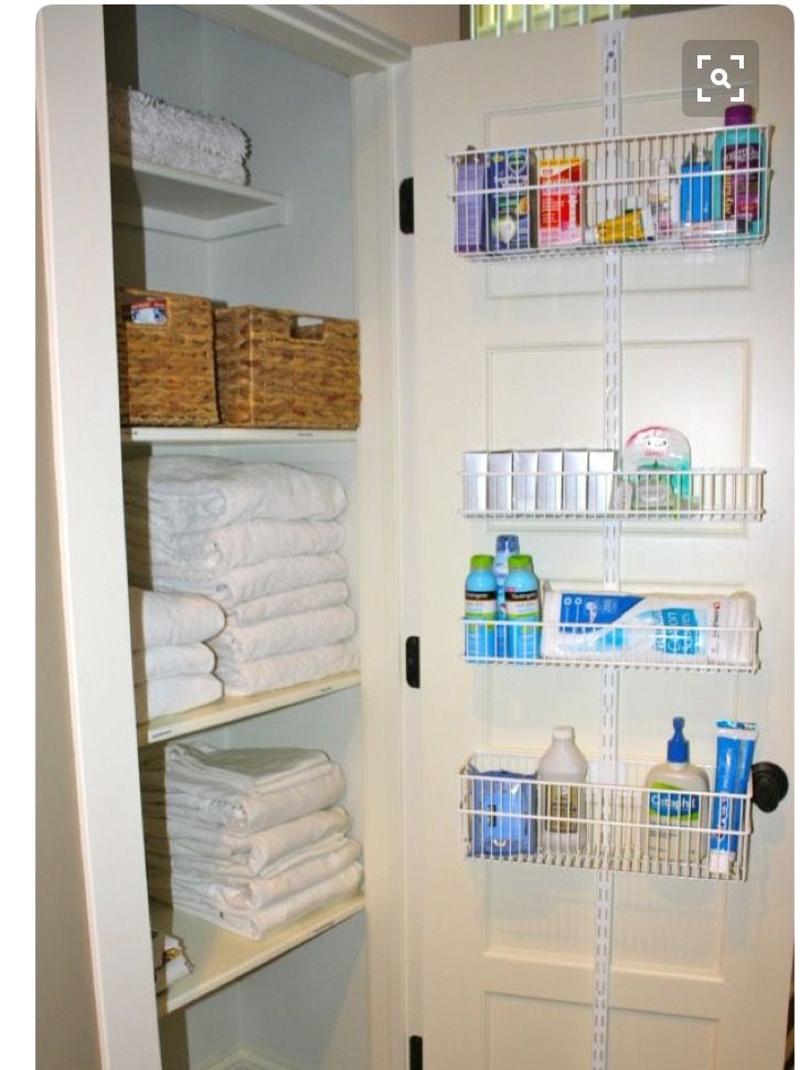 I Like This Linen Closet Makeover With The Baskets On The Back Of The Door    For A Deep Closet   Decor Ideas