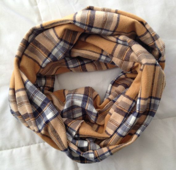 This looks so soft and cozy! Navy and mustard plaid infinity scarf by #daisydesigned on Etsy starting at $15! #plaidscarf #infinityscarf #christmasgift