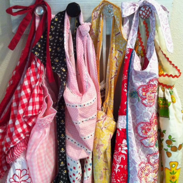 Vintage aprons (mostly) and my adorable hooks made by @Alice Hamilton