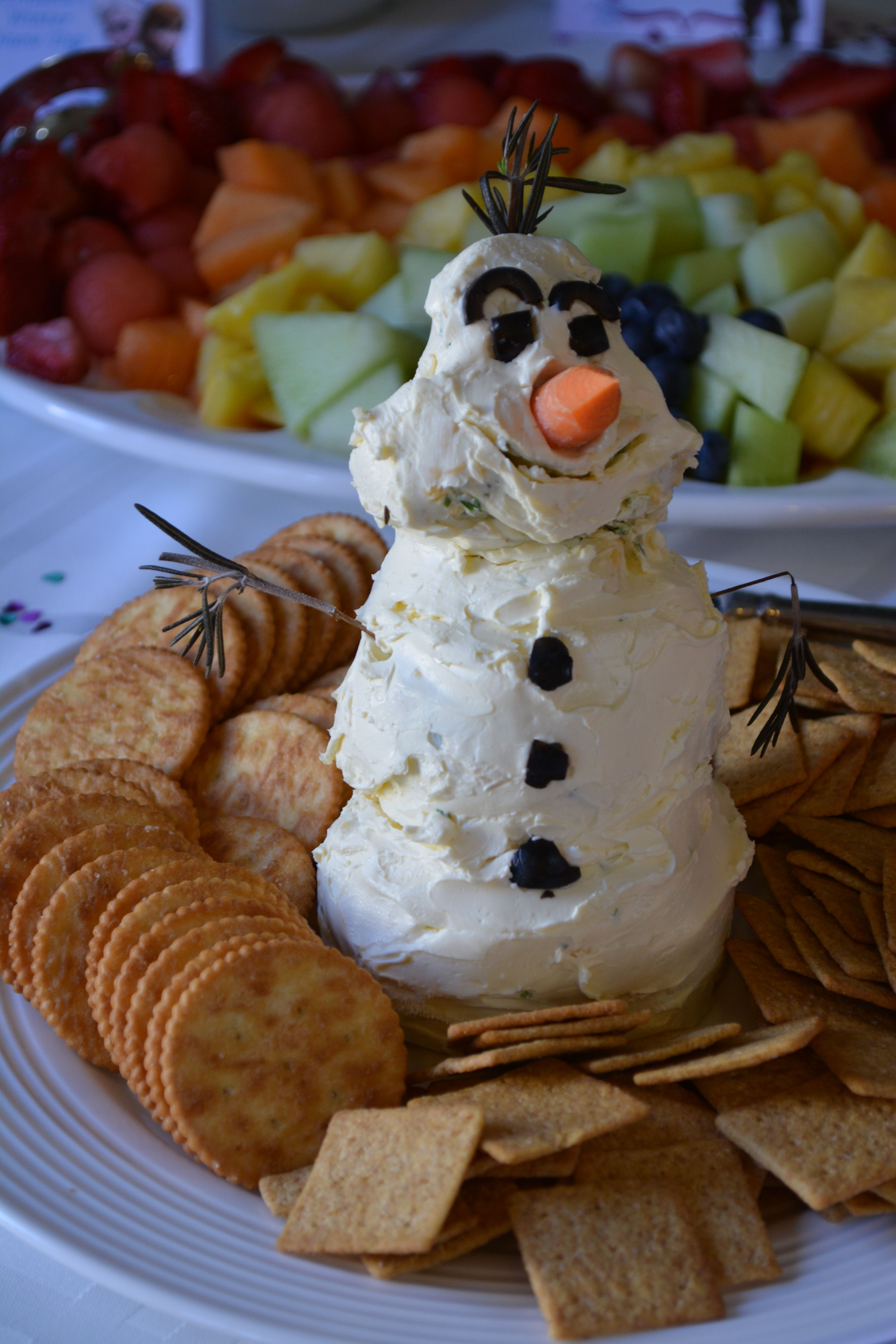 Disney Frozen Olaf cheese ball- Used this recipe but shaped it like Olaf with olives, a carrot stick and rosemary for decorating: http://www.shesaved.com/2013/11/snowman-cheeseball-inspired-disneys-frozen-disneyfrozenevent.html/#_a5y_p=1233230