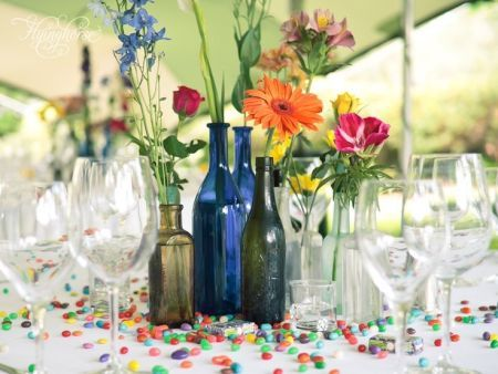 Jelly bean confetti and colorful bottles as 80th birthday