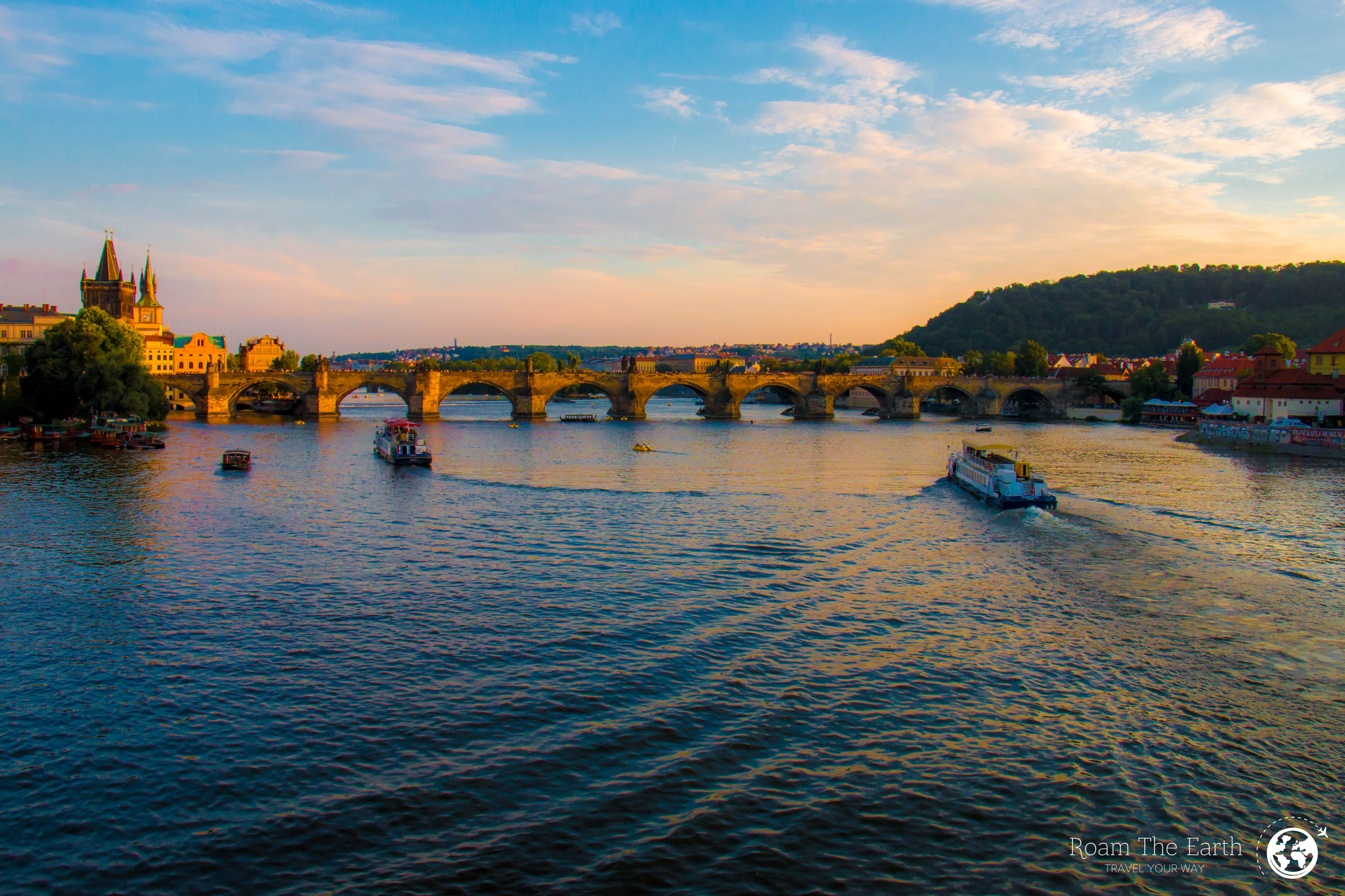 A stunning view across the Vltava river towards the Charles Bridge at sunset. A travel photo that encapsulates Prague at its finest! Travel to Prague, Czech Republic and give yourself the chance to soak in this amazing view and try some travel photography of your own!