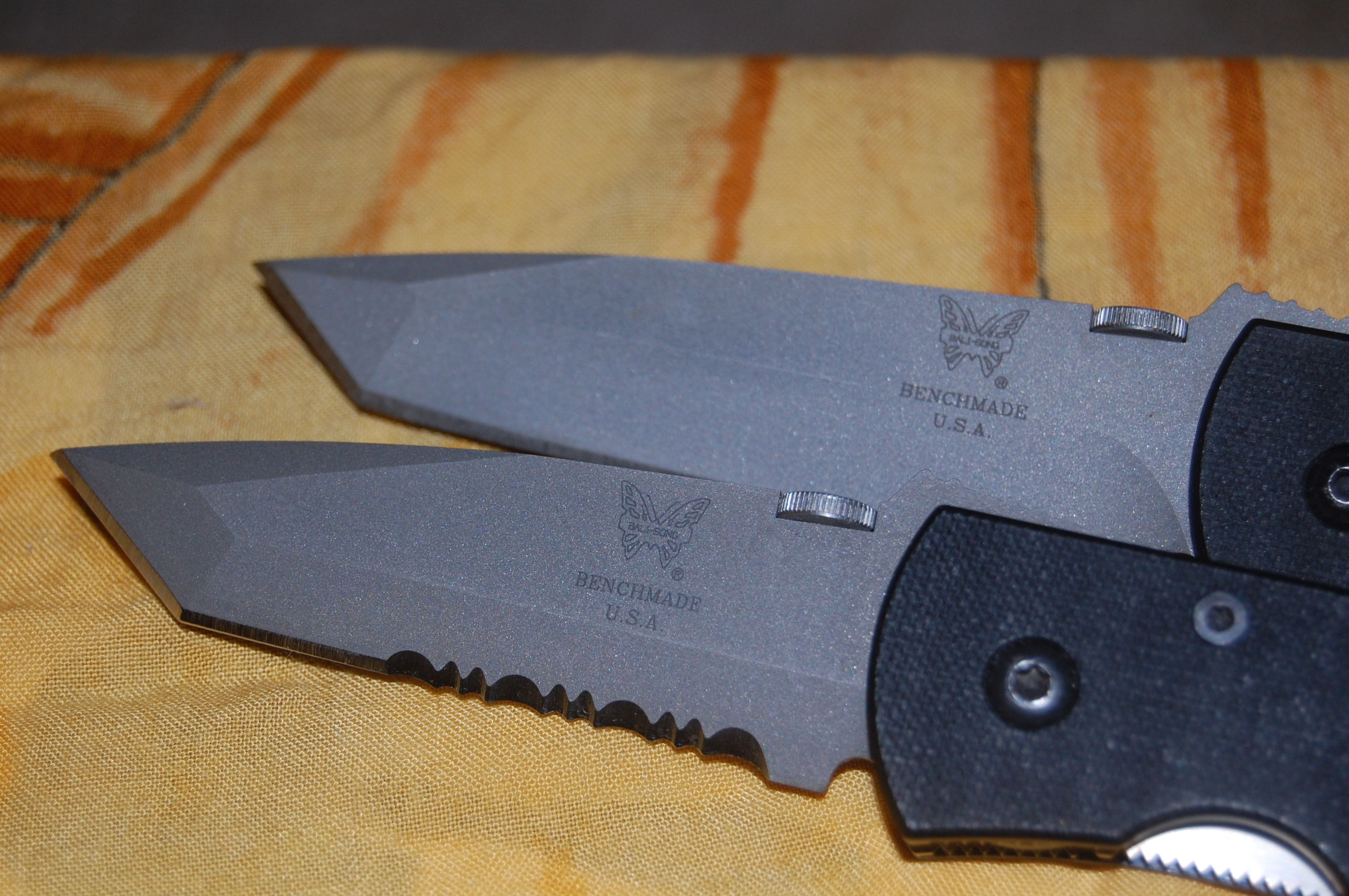 Top ats-34 steel 970 the bottom 970st titanium blade with a carbide cutting surface made for the navy seals the top is a regular production model