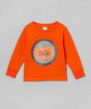 Decorated with a playfully patterned pumpkin, this all-cotton tee is the prized pick of the patch! Plus, with a personalized graphic front and center, it'll help little ghouls and gals feel extra special each time they sport it.