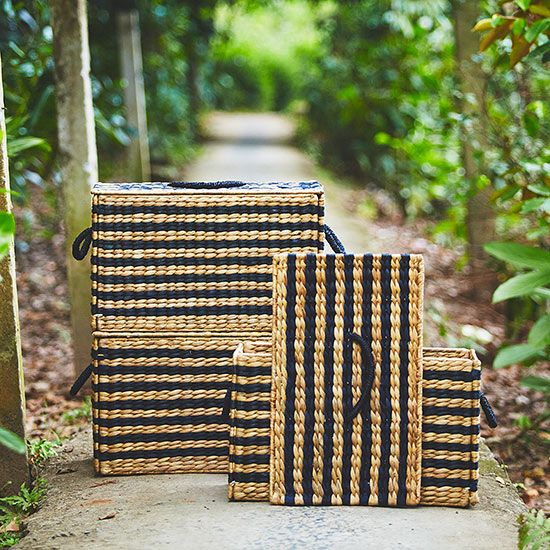 This box-meets-basket has everything we've ever dreamed of when it comes to storage: a lid for hiding our stuff, handles for easy toting, and of course, loads of style (thanks to the black stripes). Because they're handmade, every box is one-of-a-kind.