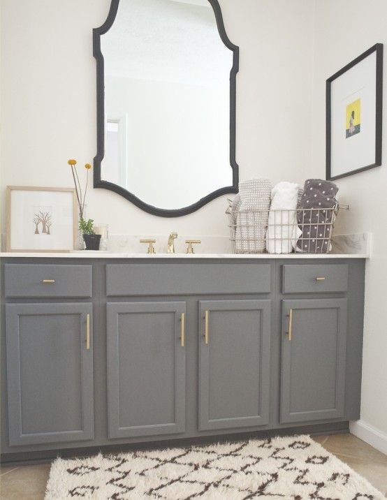 Nice bathroom design with grey cabinets, white walls, framed mirror ...