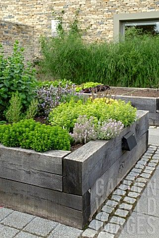 DIY Raised herb garden isn\'t that hard to make. Alhtough it works ...