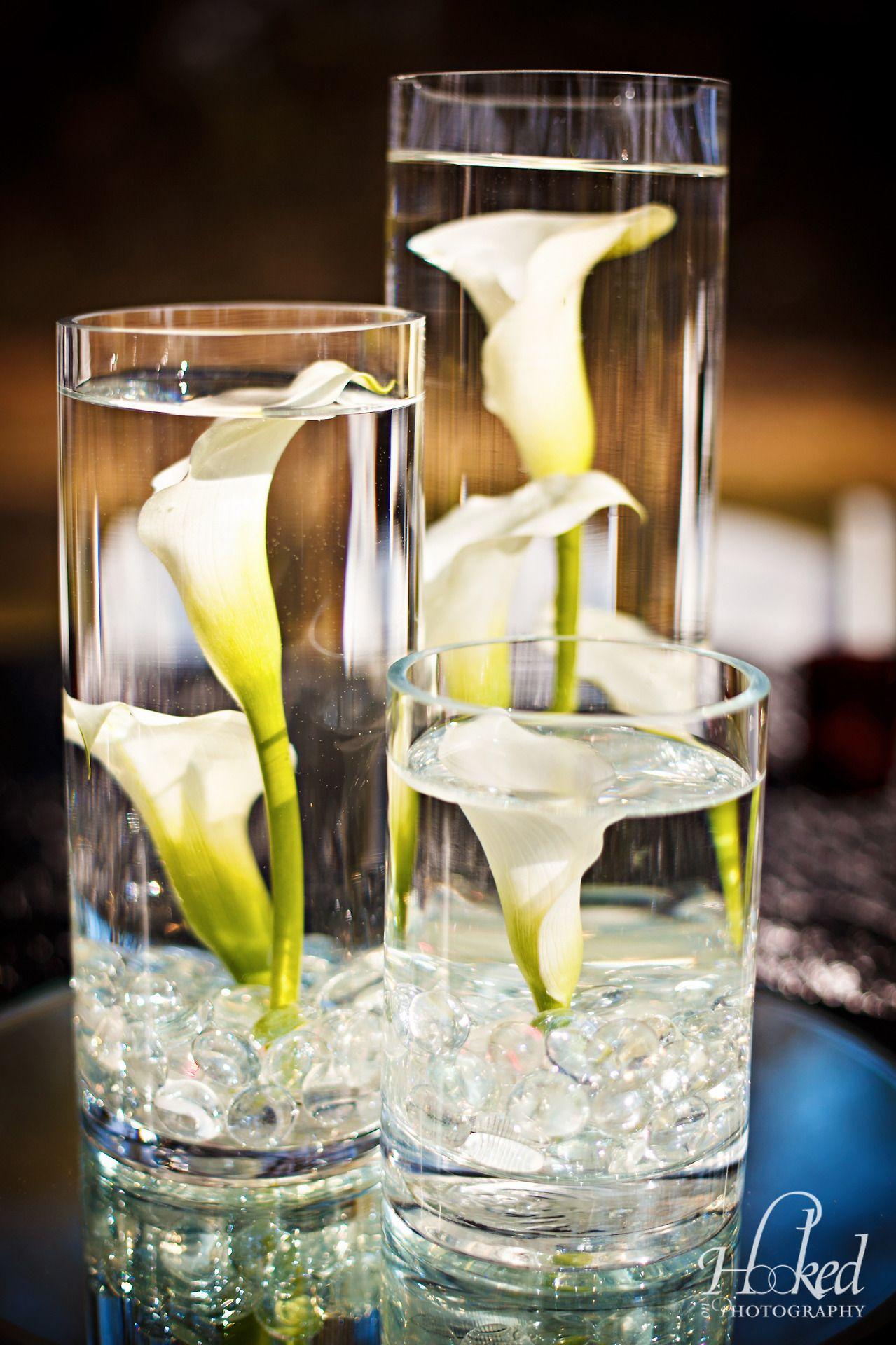 White submerged calla lilies at wedding reception. Calla