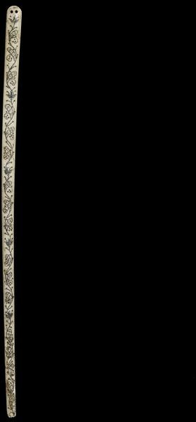 Busk, carved ivory decorated with foliage patterns in silver pique work and inset with horn, probably France, ca. 1600-1630. Carved ivory with silver piqué work, inset with horn.
