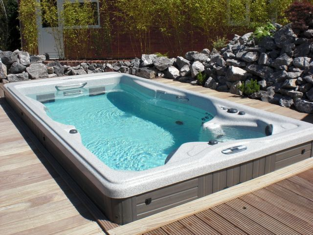 about master spas maker of the michael phelps signature swim spa outdoor deck awning living. Black Bedroom Furniture Sets. Home Design Ideas
