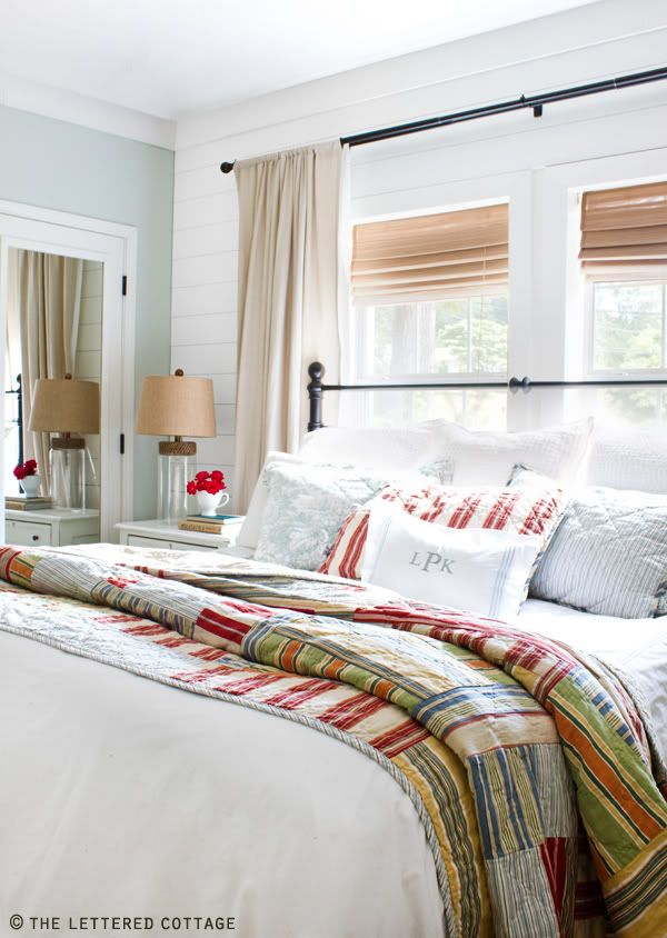 Bed in front of window. Curtains hanging on either side of bed ... : quilts for master bedroom - Adamdwight.com